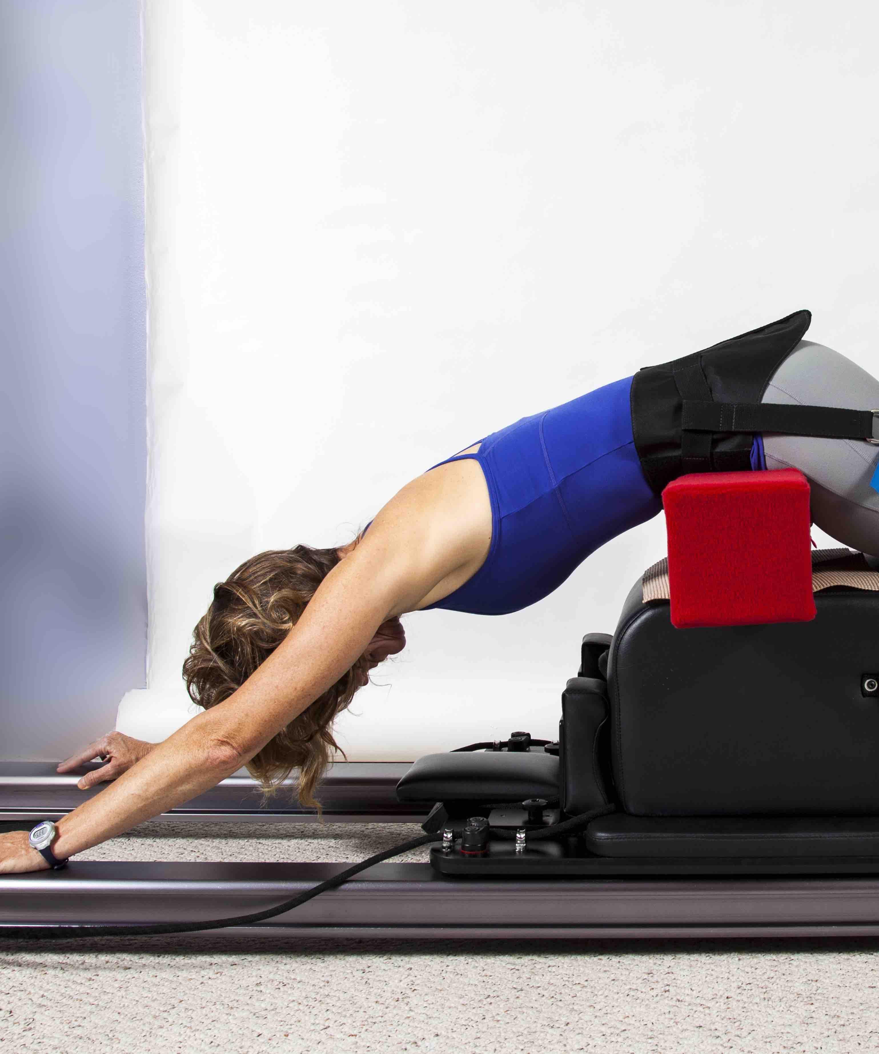 Scolio-Pilates author, Karena Thek performs an Inversion Exercise